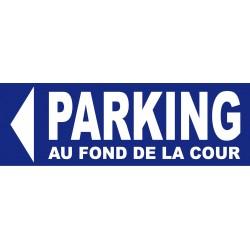panneau Parking direction gauche au fond de la cour